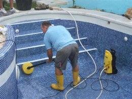Swimming pool regrouting and cleaning